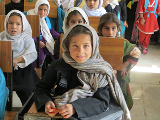 In Afghanistan, girls are given the chance to go to school.