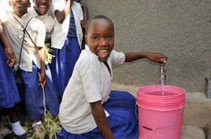 Rainwater tanks constructed at schools ensure children have access to clean water while they learn.