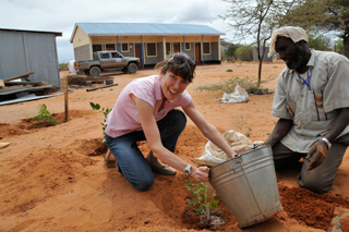 The author plants a Neem tree in Kenya—an initiative to help combat deforestation in the area.