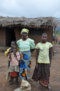 Grace and three of the children she is caring for