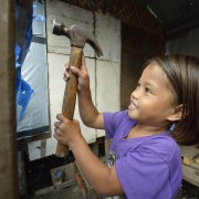 Girl helps rebuild in typhoon-ravaged Philippines city