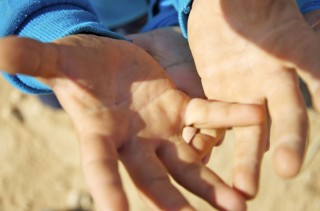 The hands of a child living at the ZaâÂÂatri refugee camp, 70 km from the Syrian border in Jordan.