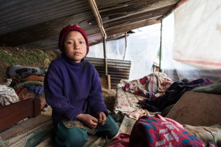 10-years-old Sasmita Susmitalopchan is sharing his temporary shelter with seven other families. Credit: ACT Alliance/FCA, Antti Helin