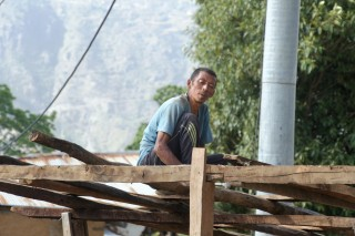 Manbahadur's rebuilds his home that was brought to the ground by the deadly quake