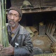 Anaju Tamang, 67, holds reeds he is going to cut and weave into a mat in the Tamang village of Goljung, in the Rasuwa District of Nepal near the country's border with Tibet. In the aftermath of the April 2015 earthquake that ravaged Nepal, the Lutheran World Federation, a member of the ACT Alliance, helped people in this village with a variety of services, including blankets, shelter and livelihood assistance.