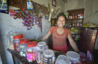 Young entrepreneur Saru Shrestha in her newly-opened shop. The project provided her with a cash grant to set up her business. (Photo: ACT Alliance/Paul Jeffrey