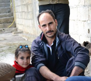 Mousa and his daughter Rihan Photo: Canadian Foodgrains Bank