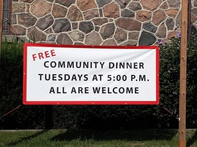 More than just a meal, Community Dinner sign