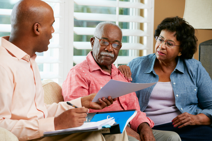 Financial Advisor Talking To Senior Couple