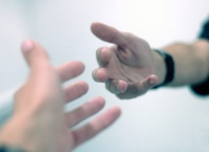 Outreached hands